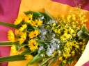 ひまわりとオンシの花束