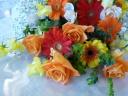 バラとガーベラの黄色オレンジ系花束