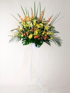 黄色とオレンジのアレンジスタンド花