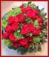 赤いバラの個性的なラウンドアレンジ