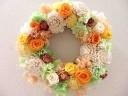 オレンジのバラのリース