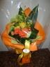 黄色、オレンジの華やかな花束