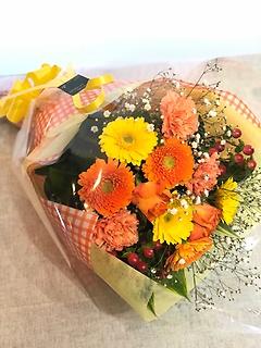 ガーベラとカーネーションとバラの花束黄色オレンジ系
