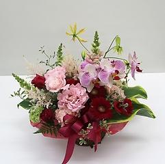 赤いお花が魅了的なアレンジメント