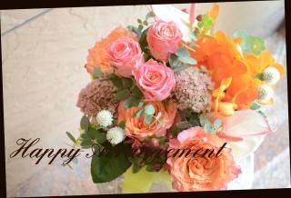 季節の花で 暖色系 アレンジメント 86