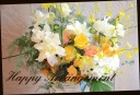 イエロー系 季節の花を入れたアレンジメント 102