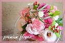 ピンク色の季節のお花で アレンジメント