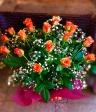 オレンジのバラとカスミソウの花束