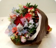 薔薇とサンキライの実のクリスマスブーケ・・・