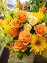 季節のオレンジ、イエロー系のアレンジメント