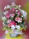 幸せの花のリングのバスケットアレンジメント