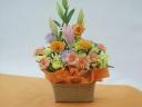 オレンジ色がお似合いのお母さんに贈るアレンジメント